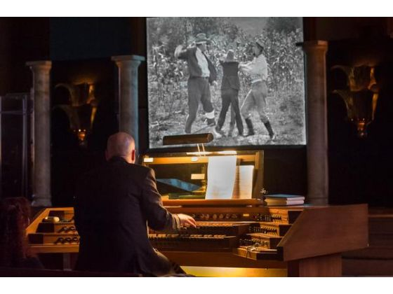 Cliff Retallick Performing a live score on a pipe organ
